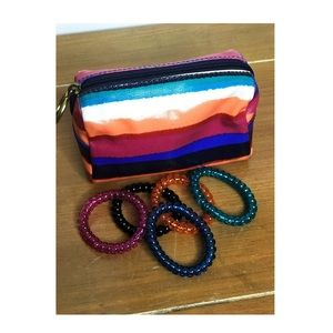 Five Multicolored Spiral Rubber Bracelets.